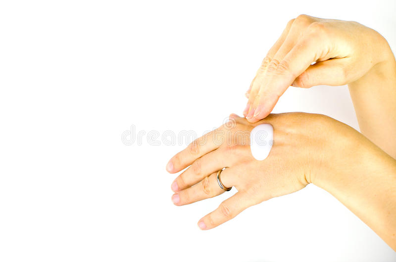 Spread white cream chapped hands royalty free stock image