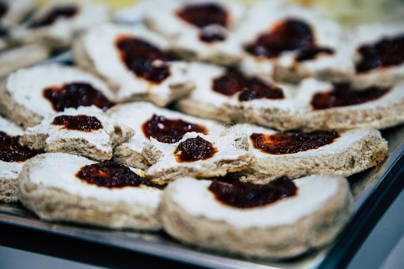 Spreadable cheese with jam on bread bites. With copy space royalty free stock photo