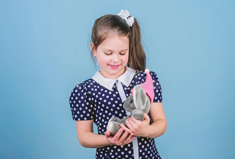 Spreading love. Kid cute girl play with soft toy mouse. Happy childhood. Child care. Sweet childhood. Childhood concept stock images