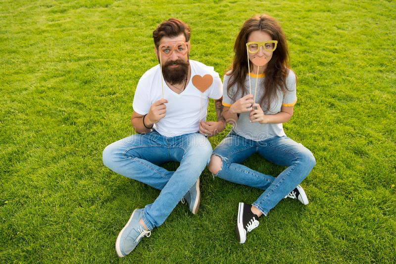 Spreading love. Romantic couple having photobooth fun on green grass. Sensual girlfriend and boyfriend having romantic royalty free stock photography