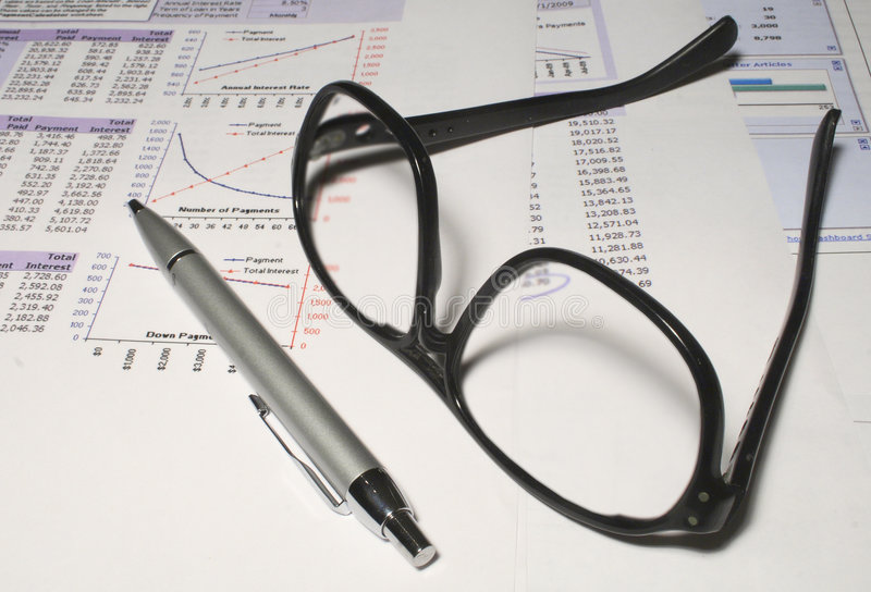 Spreadsheets And Glasses Royalty Free Stock Image