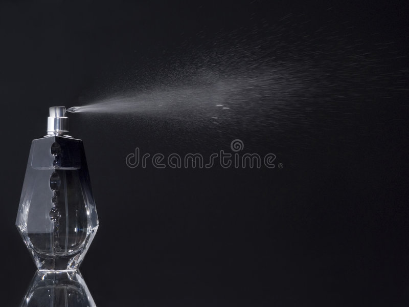 Spreaying perfume bottle stock image