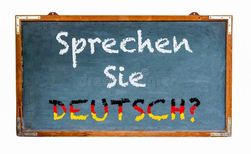"""""""Sprechen Sie Deutsch?  del †nella lingua tedesca, parlate tedesco? scritto su un'ampia vecchia lavagna di legno d'annata gr fotografia stock libera da diritti"""