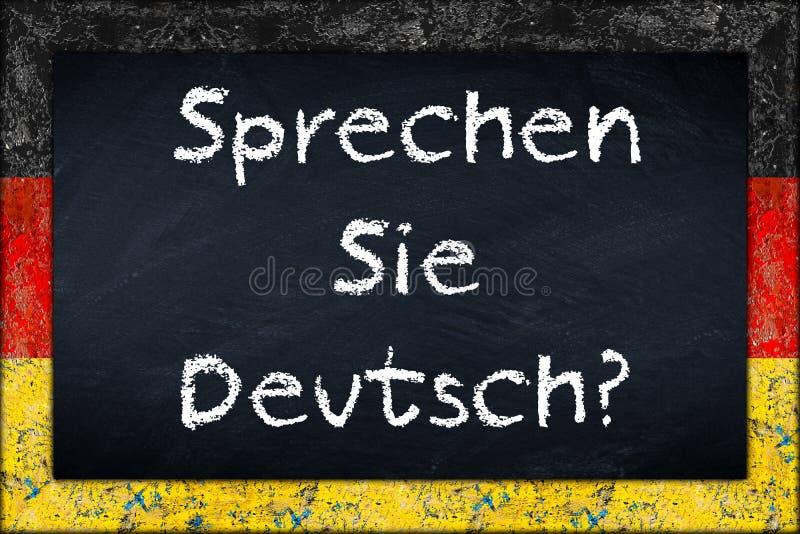 Sprechen sie Deutsch blackboard z Germany flaga ramą zdjęcia stock