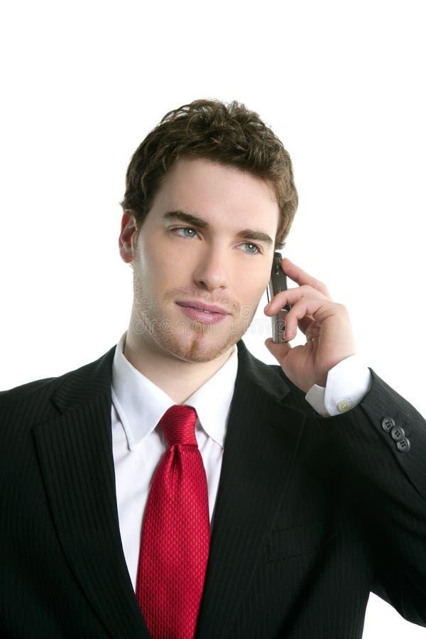 Sprechentelefon der jungen stattlichen Geschäftsmannklage stockfoto