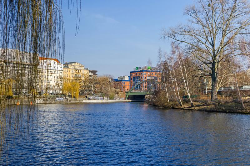 Spree river embankment Bundesratufer with the Lessing bridge and The House Lessing in Berlin, Germany stock photos