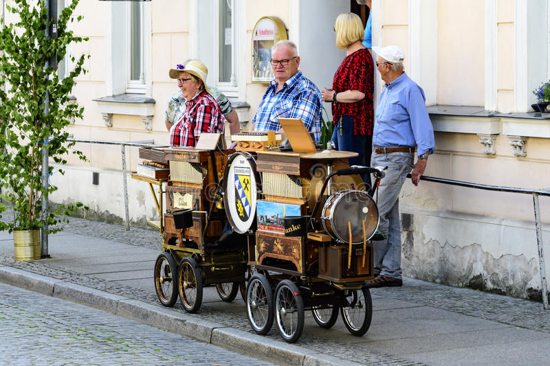 Spreewald and protection-firmly in Luebbenau 7/2/2016 Barrel organ in the street edge. Man with barrel organ with the Spreewald and protection party in Lü royalty free stock photography