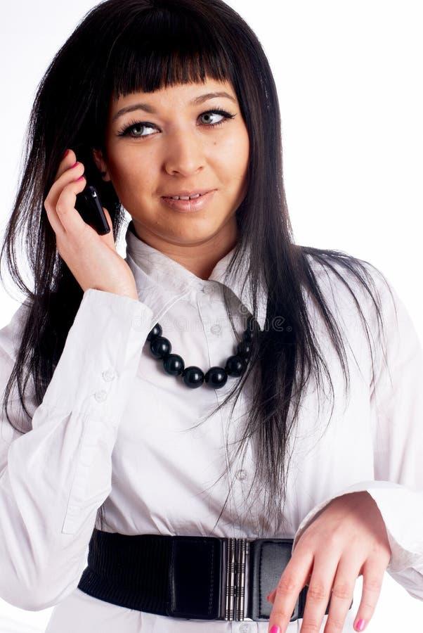 Sprekend meisje door mobiel royalty-vrije stock foto