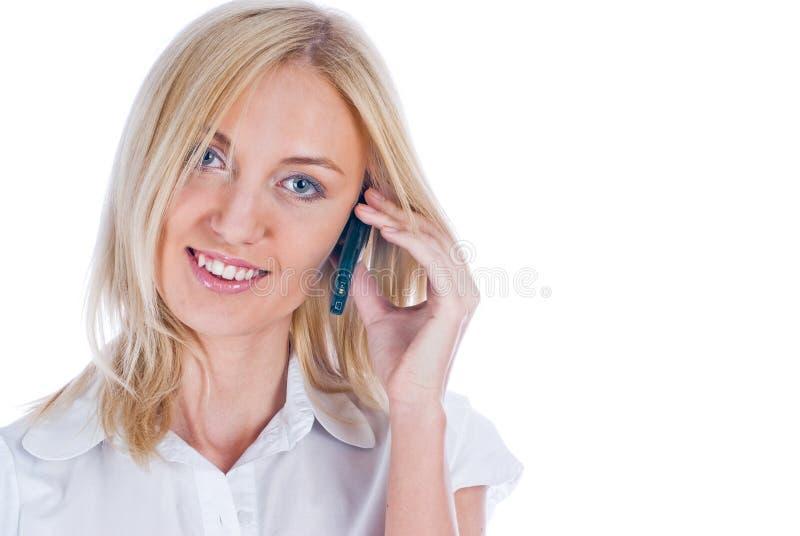 Sprekend meisje door mobiel stock afbeeldingen
