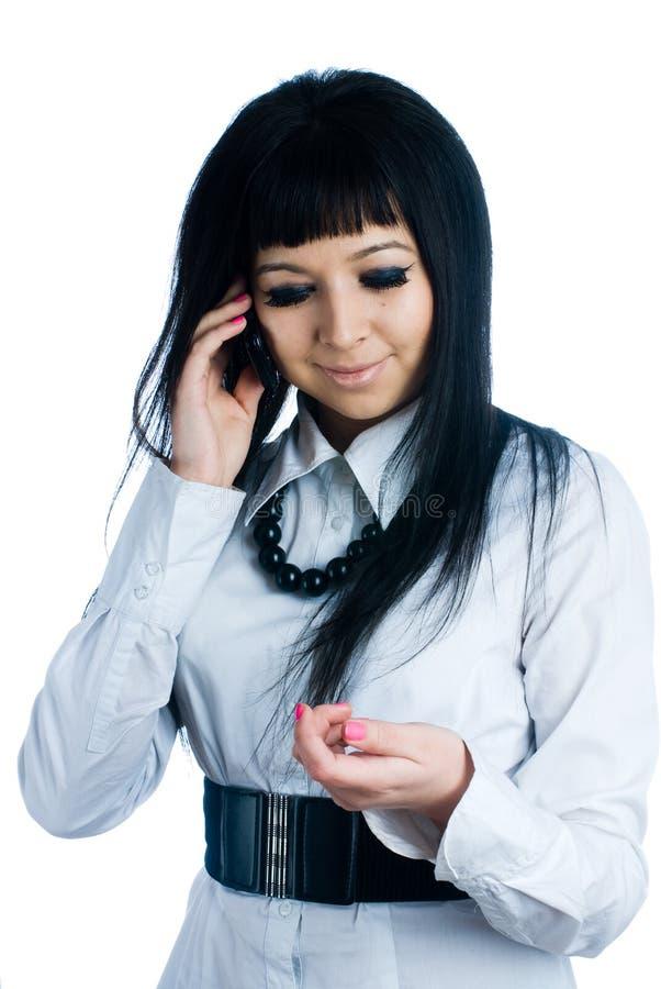 Sprekend meisje door mobiel royalty-vrije stock foto's