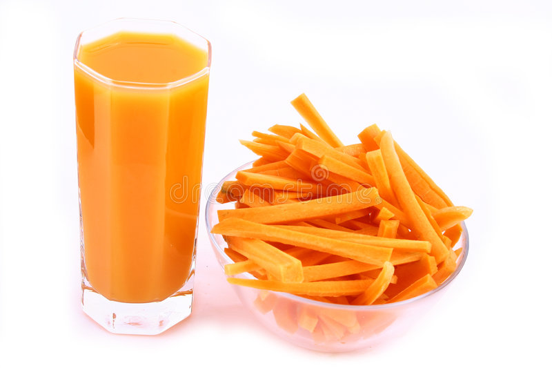 Spremuta di carota fresca isolata fotografie stock