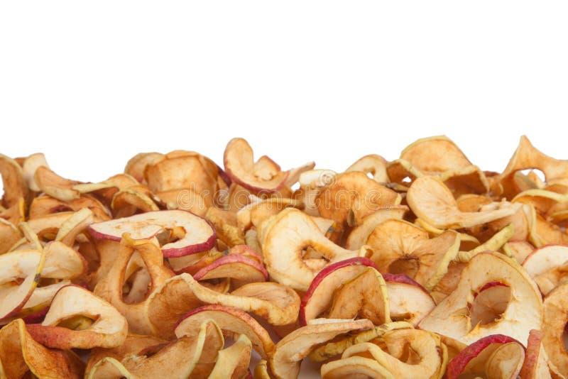 Spridda torkade äpplen som isoleras på vit bakgrund royaltyfria foton