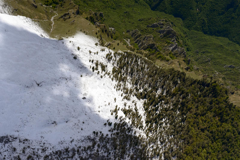 Sprimg snow on Arera slopes, Orobie, italy. Aerial shot, from a small plane, of the slopes of Arera peak range with recent springtime snow, shot in Orobie royalty free stock photo