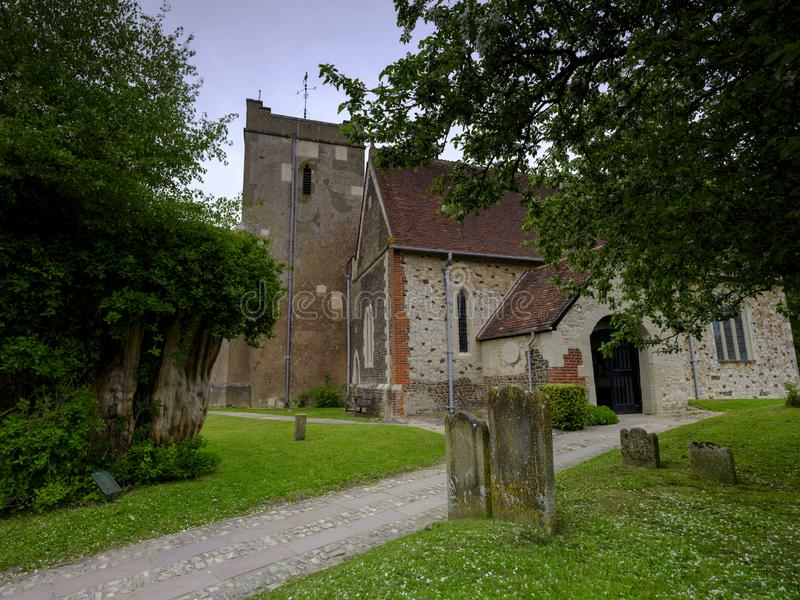Spring afternoon light on an overcast day - View of St Mary`s Church in Selborne, Hampshire, UK royalty free stock images