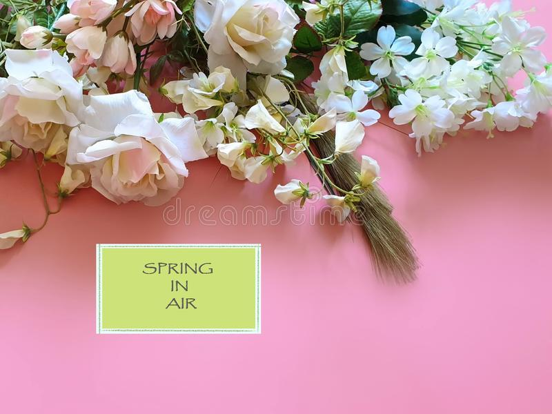 Spring In Air Quotes Beautiful Flowers  bouquet of white roses and wild flowers on a pink background  copy spaces stock photography