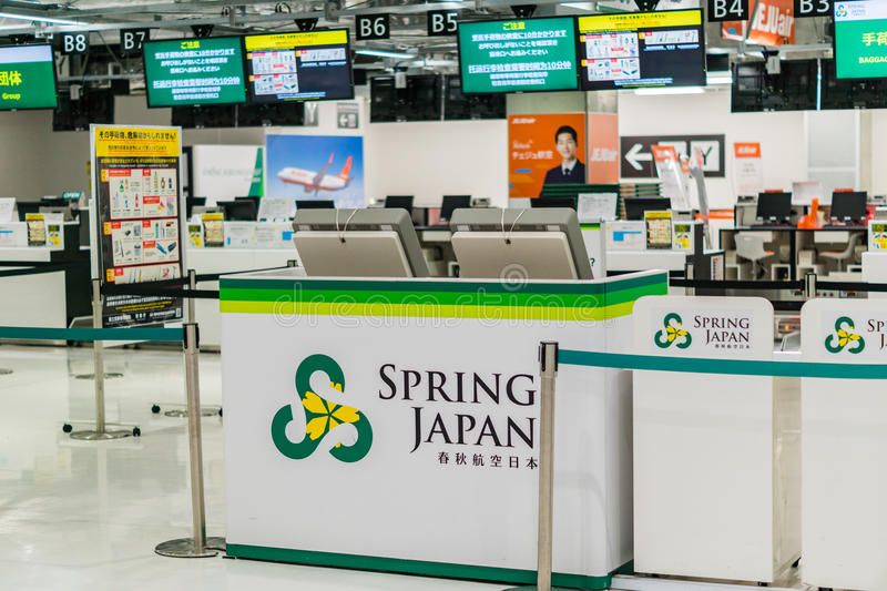 Spring Airline check-in counter at Narita airport, Japan. Spring Airline Japan ticket counter at Narita airport, Japan. Spring Airlines is a low-cost carrier royalty free stock photo