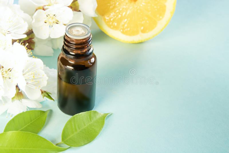 Spring aromatherapy with citrus and essential oils. And flowers stock photography
