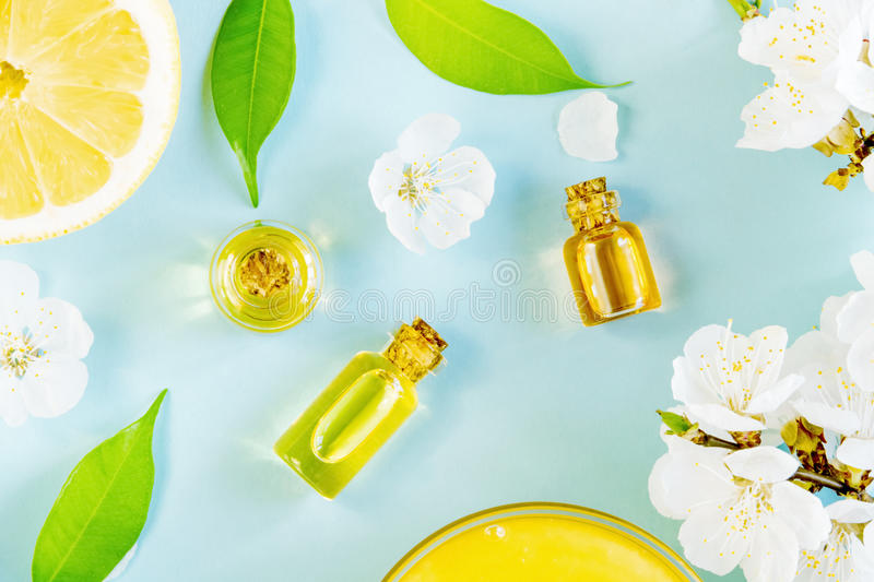 Spring aromatherapy with citrus and essential oils. Spring aromatherapy with citrus, essential oils and flowers royalty free stock image