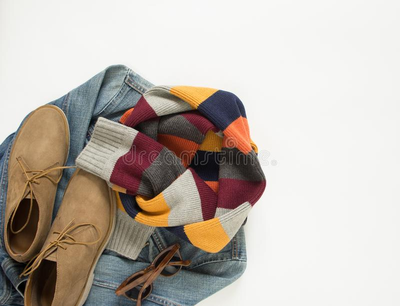 Spring, autumn female outfit. Set of clothes, shoes and accessories on white background. Blue denim jacket, stripe scarf and cream stock image