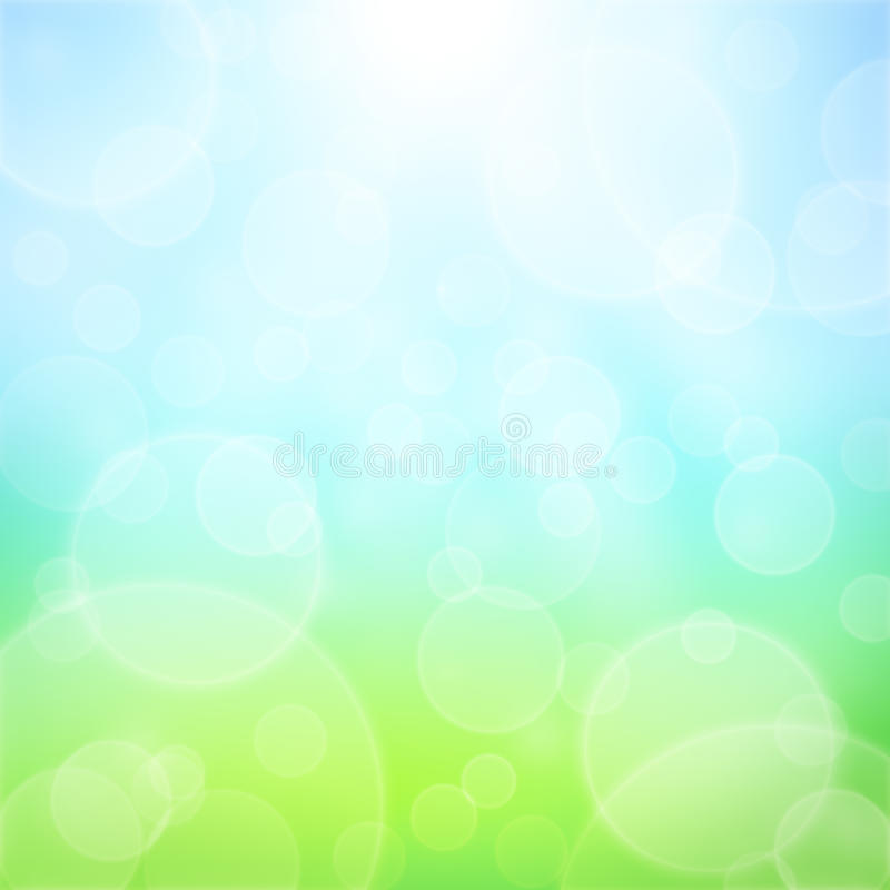 Spring Background. Spring abstract background with bokeh and sun rays. Grass and blue sky stock photography