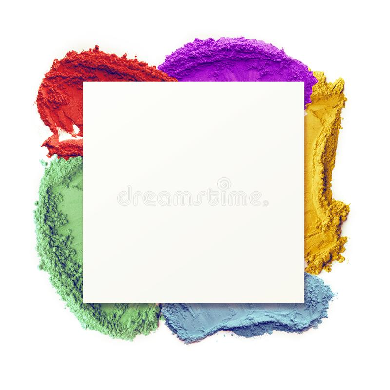 Spring background with blank space and colored holi powder. Spring background with square blank space surrounded by colored holi powder on background stock photo