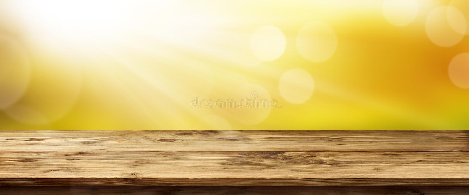 Spring background with sunrise and table. Spring background panorama with golden sunrise and empty wooden table for a concept royalty free stock images