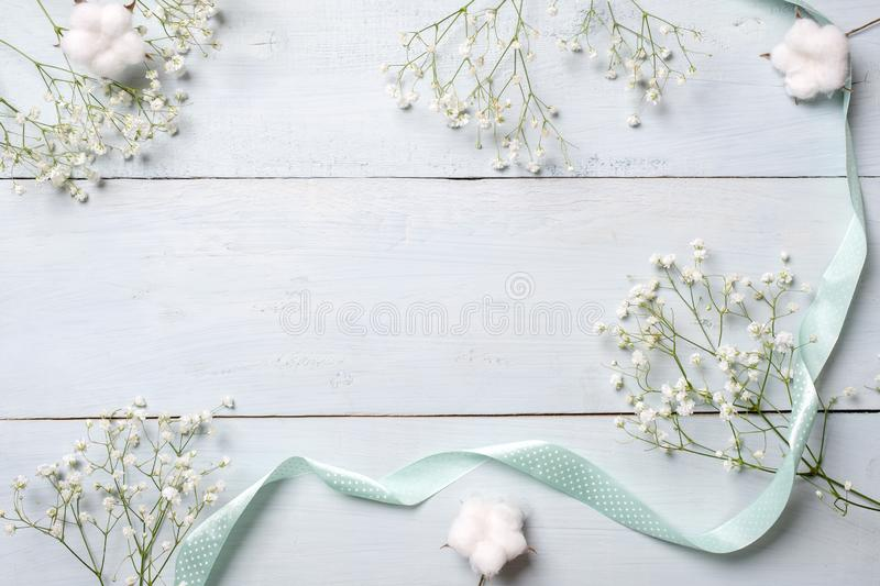 Spring background. White rustic flowers on blue wooden table. Banner mockup for womans or mother day, happy easter, spring holiday. S. Backdrop with copy space stock photos