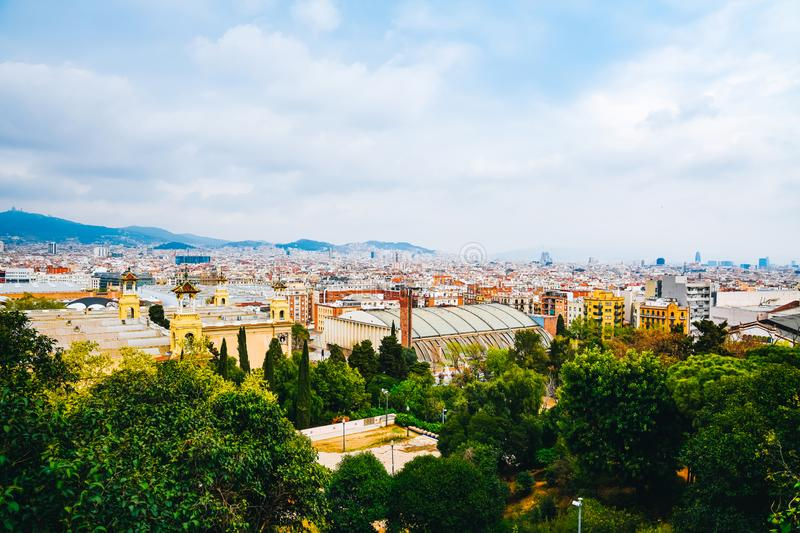 Spring Barcelona general view on a cloudy day from mountain Montjuic. Clouds, beautiful landscape, urban streets, roofs, blooming stock photo