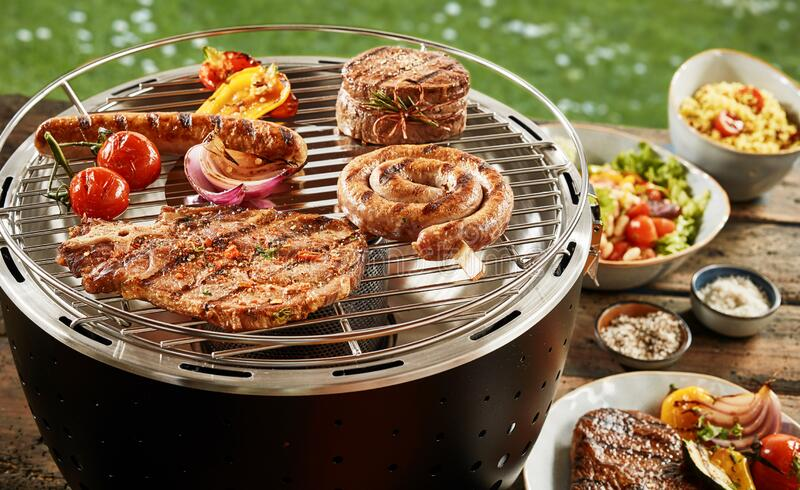 Spring BBQ with assorted meat and salads royalty free stock photos
