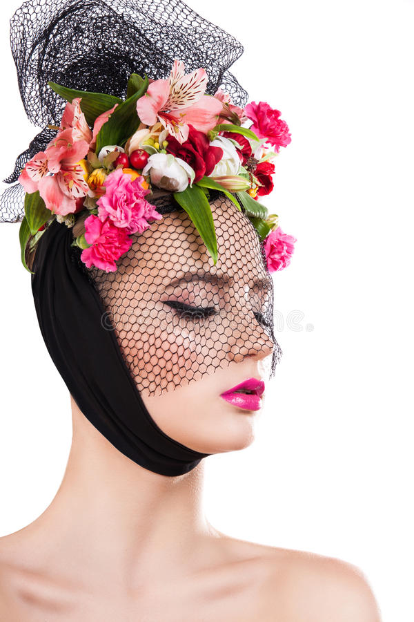 Spring beautiful girl in veil with flowers in her hair. stock photo
