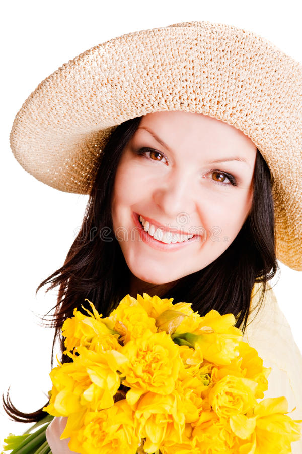 Spring beautiful woman holding flowers over white. Background stock photo