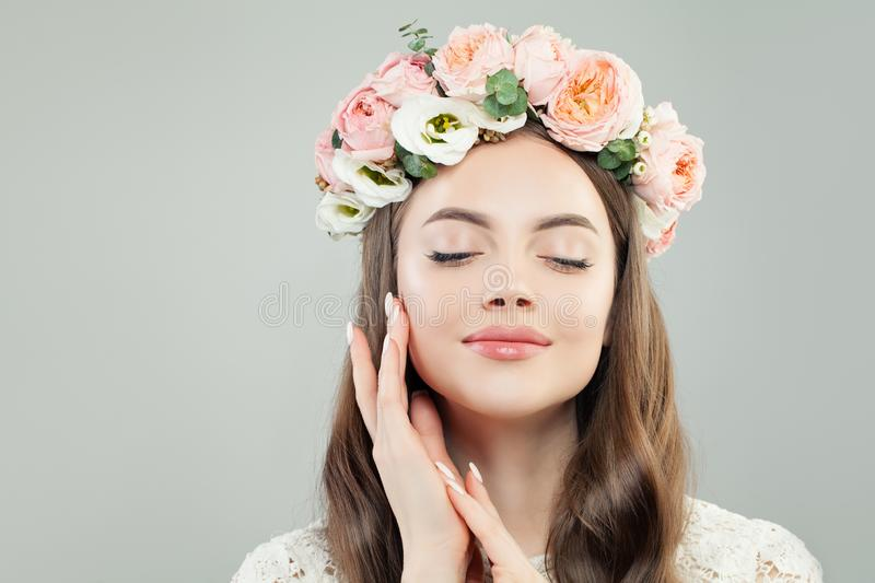 Spring Beauty Portrait of Enjoying Model Woman with Flowers.  stock photo