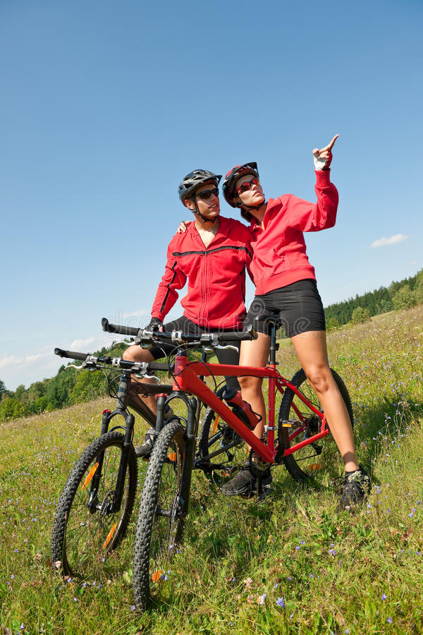 Download Spring Bike - Young Sportive Couple In Meadow Stock Photo - Image: 10857830