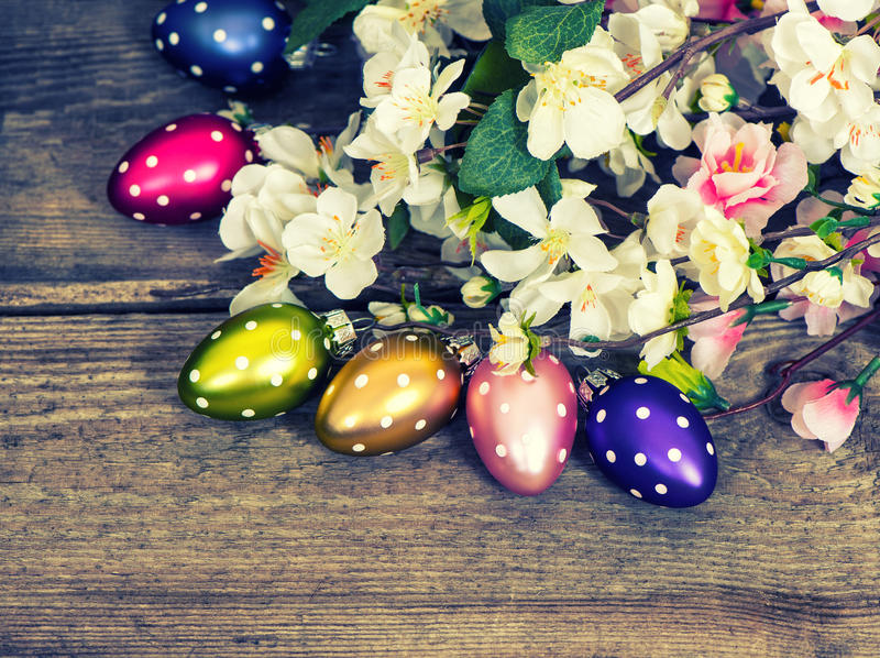 Spring blossoms and easter eggs decoration. Retro style. Spring blossoms and easter eggs decoration on rustic wooden background. Retro style toned picture stock images