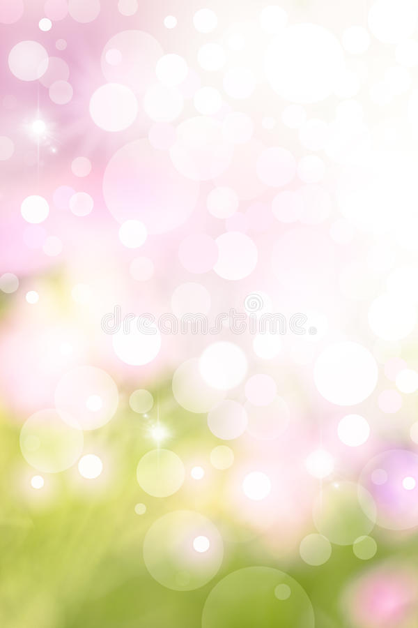 Spring Bokeh Background. A bright spring background with green and pink bokeh effects