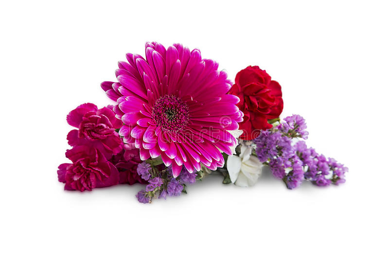 Spring bouquet with gerbera and purple flowers isolated on white royalty free stock image