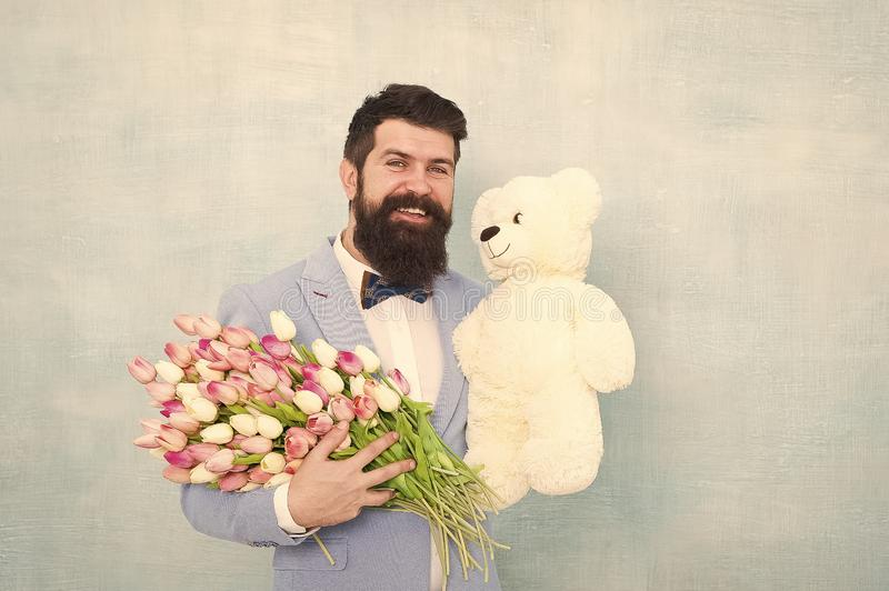 Spring bouquet. 8 of march. bearded man in bow tie with tulip flowers. love date with flowers. Happy Birthday. bride stock photo