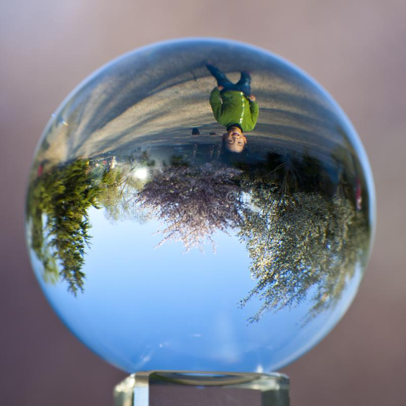 Spring boy in crystal, Beijing Yuyuantan park. Upside down spring boy in crystal ball, scenery in Beijing Yuyuantan Park famous with cherry flowers stock images