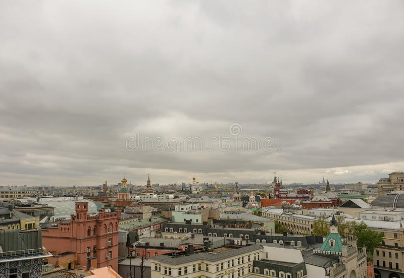 Spring cityscape with roofs of houses, bathing churches and cloudy sky, view from above.  Center of Moscow, view from height stock photography