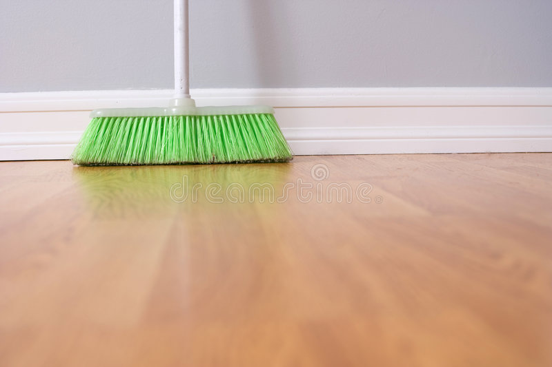 Spring Cleaning. Broom against wall royalty free stock photography