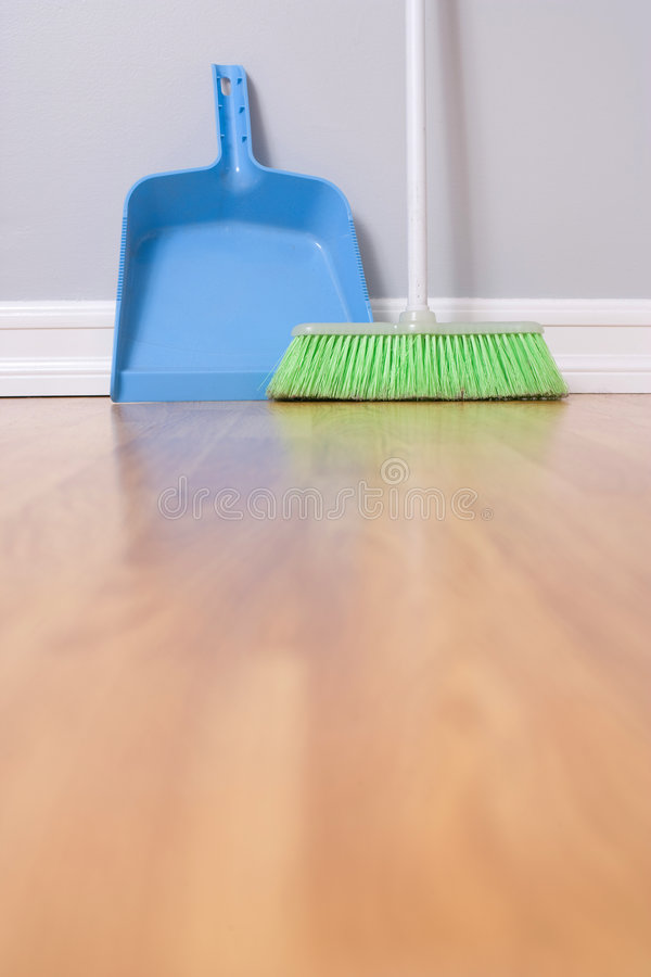 Spring Cleaning. Broom against wall royalty free stock photos