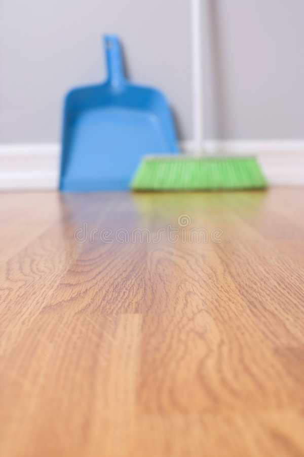 Spring Cleaning. Broom against wall focus on floor royalty free stock photo