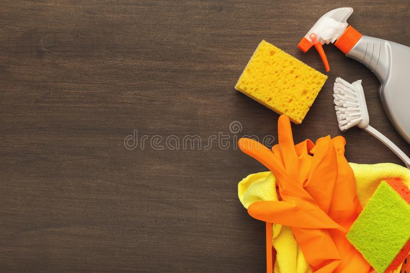 Various cleaning supplies, housekeeping background. Spring cleaning background. Assortment of colorful spray detergents, sponges, rags and other supplies on royalty free stock images
