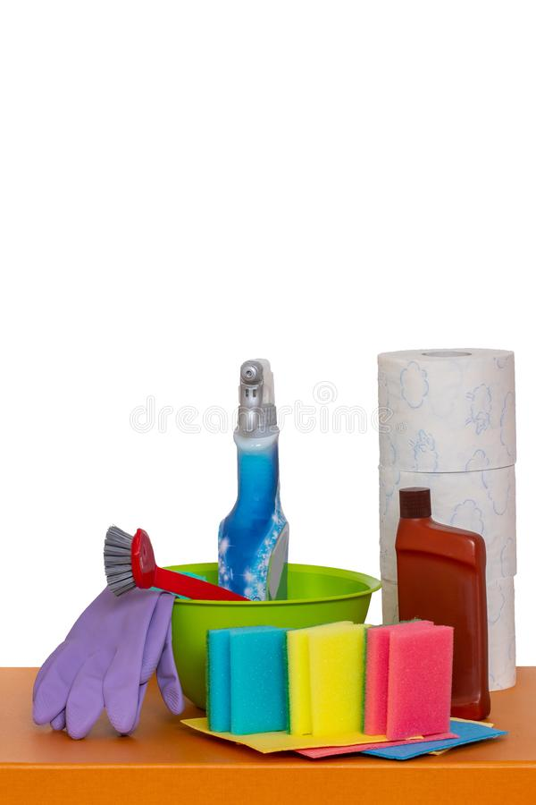 Spring cleaning background. Close-up of house cleaning products and cleaning supplies on orange wooden table isolated on a white. Background. Household chore stock image