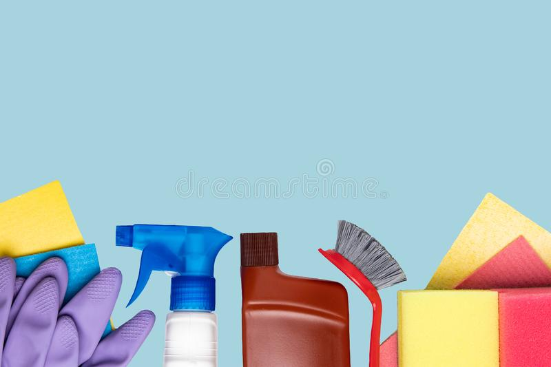 Spring cleaning background. Close-up of house cleaning products and cleaning supplies over light blue background. Household chore stock images