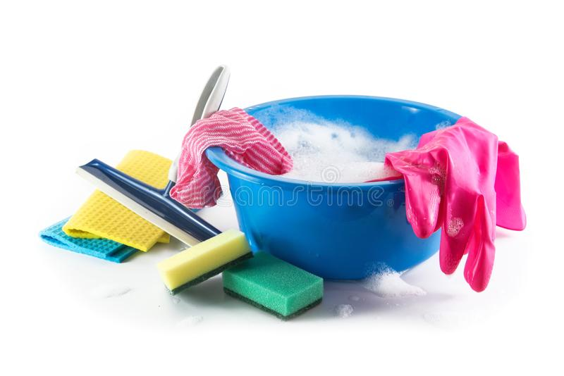 Spring cleaning, blue plastic bowl with soap foam and colorful h. Ousehold utensils such as cleaning cloth, sponges and rubber gloves, isolated with shadow on a royalty free stock photography