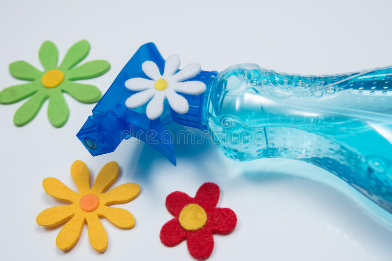 Spring-cleaning. With bottle and flowers royalty free stock image