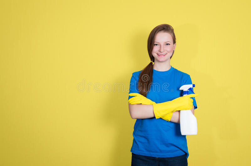 Spring cleaning. Cleaning woman with cleaning spray bottle happy stock images