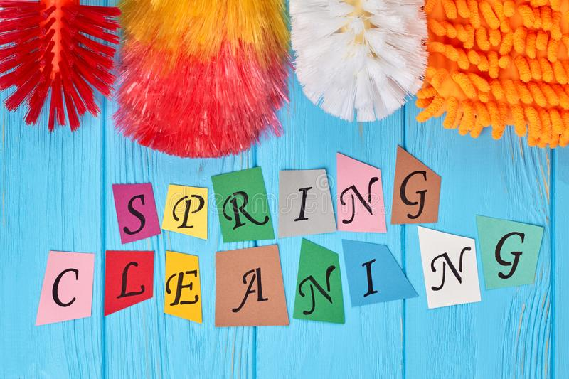 Spring cleaning colorful background. Spring cleaning colorful papercut letters. Home cleaning concept stock photo