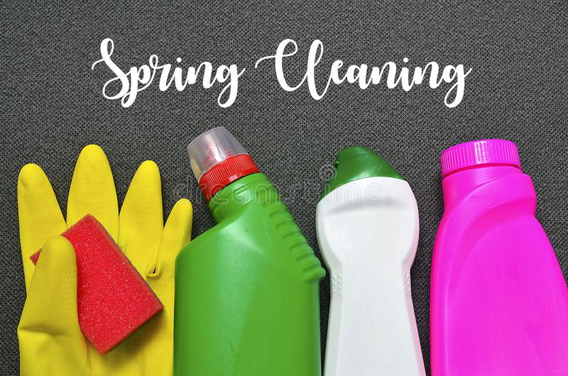 Spring cleaning concept.Colorful set of cleaning supplies with text. royalty free stock photography